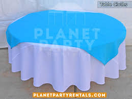 round table with white table cloth and light blue overlay runner