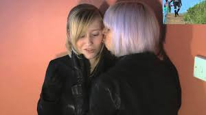 cute girl in leather gloves boots pants gloves jacket kissing walking putting on leder hosen you