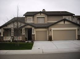 dark brown exterior paint fashionable brown light exterior wall color with fancy garage door and