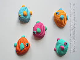 A fun summer craft with all those shells from the beach! Tropical Seashell  Fish Craft