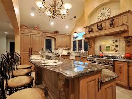 mediterranean kitchen with two tiered island photo source kitchen designs
