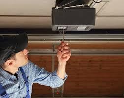 garage door repairmanFlorida Sliding Glass and Garage Door Repair
