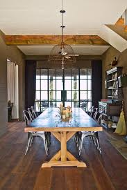 farm dining room table. Industrial French Doors At The End Of This Farmhouse Dining Room Allow Light To Fill Gathering Space. A Table Surrounded By Metal Bistro Farm