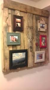 electrical panel cover a framed mirror on hinges attractive and my own pallet art covers the breaker panel in my basement