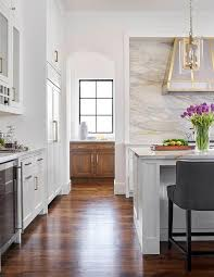 Wood Stove Backsplash Cool Elegant White Kitchen With A Stove Nook Features A Gray And Gold