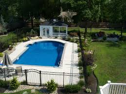 Swimming Pool:Incredible Backyard Pool Landscaping With Neutral Water  Fountain And White Umbrella Nice Looking