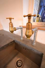 beautiful reclaimed brass globe taps finish off the look of this