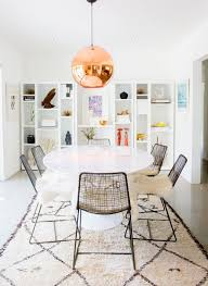modern and funky this dining room uses the beni ourain rug to frame the furniture and create a focal point in the center of the room