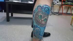 татуировка чеширский кот и гусеница