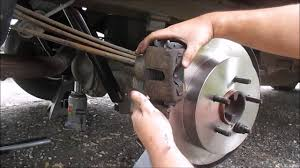 How to Change Rear Rotors and Brake Pads on a Ford F150 - YouTube
