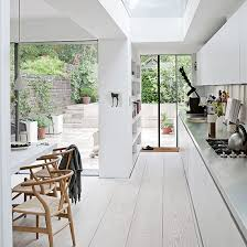white kitchen wood floor. Perfect Kitchen White Painted Wood Floor With Modern Cabinetry On Kitchen Wood Floor K
