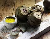 artichokes sauteed in herb infused butter