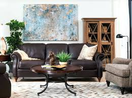 living room with white walls layered sisal and rugs brown leather sofa trending colors 2016 are