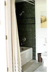 we had the ugliest ceramic tile tub and shower surround ever and wanted a quick
