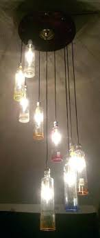whiskey bottle chandelier chandeliers chandelier made from 1 liter glass bottles chandelier hangs about long whiskey