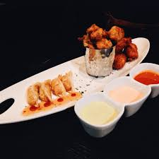 White Oak Kitchen Houston Kitchen Sampler Chicken Potstickers Japanese Calamari And