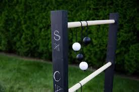 diy ladder ball with chalkboard score keeper