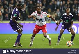 BRUSSELS, BELGIUM - NOVEMBER 24: Ilombe Mboyo of Kv Kortrijk battles for  the ball with Derrick Luckassen
