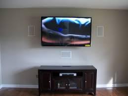 flat screen tv on wall with surround sound. port city av custom installation of 60\ flat screen tv on wall with surround sound u