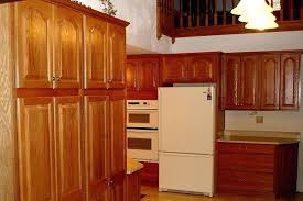 quartz countertops with oak cabinets kitchen after the natural cherry