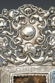 south american silver filigree frame with oil of saint francis