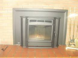 23 milan fireplace insert in brick fireplace second picture shows 4 clean out t with piping mr s enjoys the finer things in life and his pellet