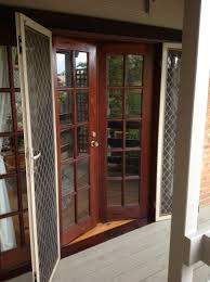 timber french doors with colon