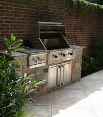 custom stone outdoor grill with granite countertop and stainless steel drawers in alexandria va