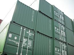 Made to be Moved : Worn-out shipping containers are stacked three stories  high