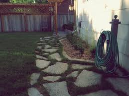 a flagstone walkway in an existing lawn
