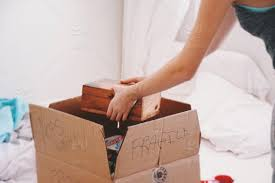 Start Boxes Girl Packing A Box For Moving Stock Photo 4a6a8034 63c0 49b6 Ba2d