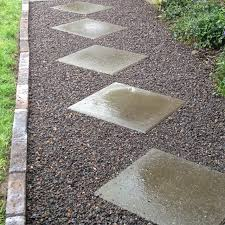 decorative brick pavers. the grounds are full of gravel pathways, some marked by decorative pavers or flagstone. brick c