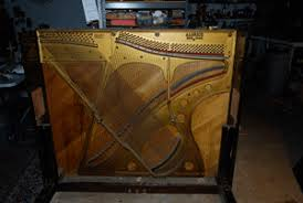this is the harp where all the strings reside if you look only at the right side you can easily envision a harp and one can pluck the strings and make  on piano harp wall art with diane lou found object art february 2012