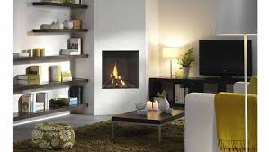 living room interior living room furniture square wall mount electric fireplace with brown wooden floating shelves beside and ructic brown wooden coffee