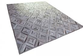 general view of a taupe and cream diamond patchwork cowhide rug