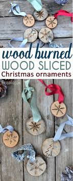 DIY snowflake ornaments using a wood burner on wood slices or tree slices.  A fun