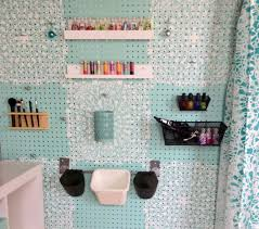 A DIY stenciled pegboard using the Stephanie's Lace Allover Stencil.  http://www