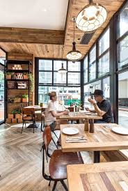 modern coffee shop with interior clad with wood and interacting with the  street through large windows