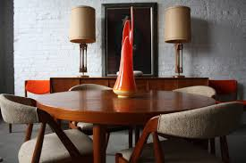 modern dining room design and decorating in vine style with brown varnished wooden dining chairs with grey velvet seat cover and