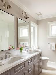 white and gray bathroom features a gray double washstand ed with his and hers sinkodern faucetetal framed mirrors illuminated by boston