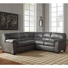 gray leather couch. Ashley Signature Design Bladen Two-Piece Faux Leather Sectional   Rooms And Rest Sofas Gray Couch E