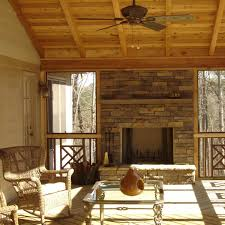 the owners of this space wanted a screened porch they could enjoy on both warm and
