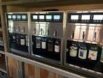 Best golf snack shack ever! A nice rack full of wines by the taste ...