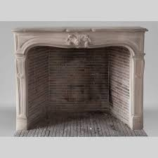 beautiful antique louis xv style fireplace in stone decorated with a palmette