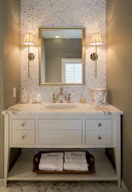 powder room bathroom lighting ideas. a custom made vanity painted in crisp white paint is perfectly paired with marble powder room bathroom lighting ideas