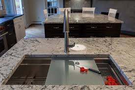 bright kohler kitchen faucet in kitchen transitional with kohler alteo faucet next to supreme gold granite