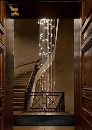 stairwell lighting. not sure which is more spectacularthe stairway or the lighting cascading lights within a winding staircase stairwell g