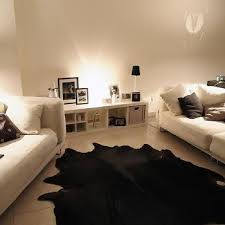homey idea black cowhide rug and white design ideas australia nz solid brown friday angus