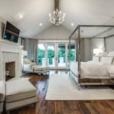 Vaulted Ceiling Adds Drama in Luxurious Master Bedroom
