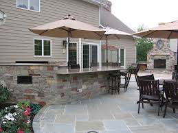 patio outdoor stone kitchen bar:  attractive stone backyard outdoor bar and kitchen area new jersey